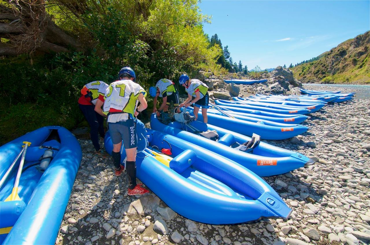 Getting in the Godzone canoes for the canoe down the Waiau