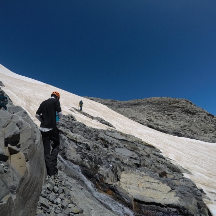 Made it around the scree ledge, now just up the snow slope