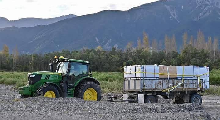 Bike Boxes stacked on a silage trailer and driven into the Clarence river valley